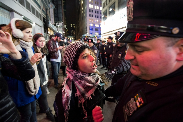 A protester confronted a member of the NYPD at a protest last year over the Eric Garner decision. (Photo: Daniel Cole)