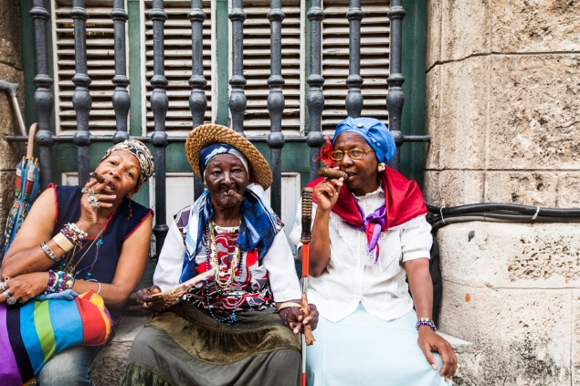 Cigar smokers hanging out on Obispo Street in Havana, Cuba. (Photo by Emily Assiran)