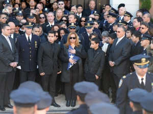 Maritza Ramos, wife of New York Police Officer Rafael Ramos, holds the colors as she is joined by her sons Justin and Jaden. (DON EMMERT/AFP/Getty Images)