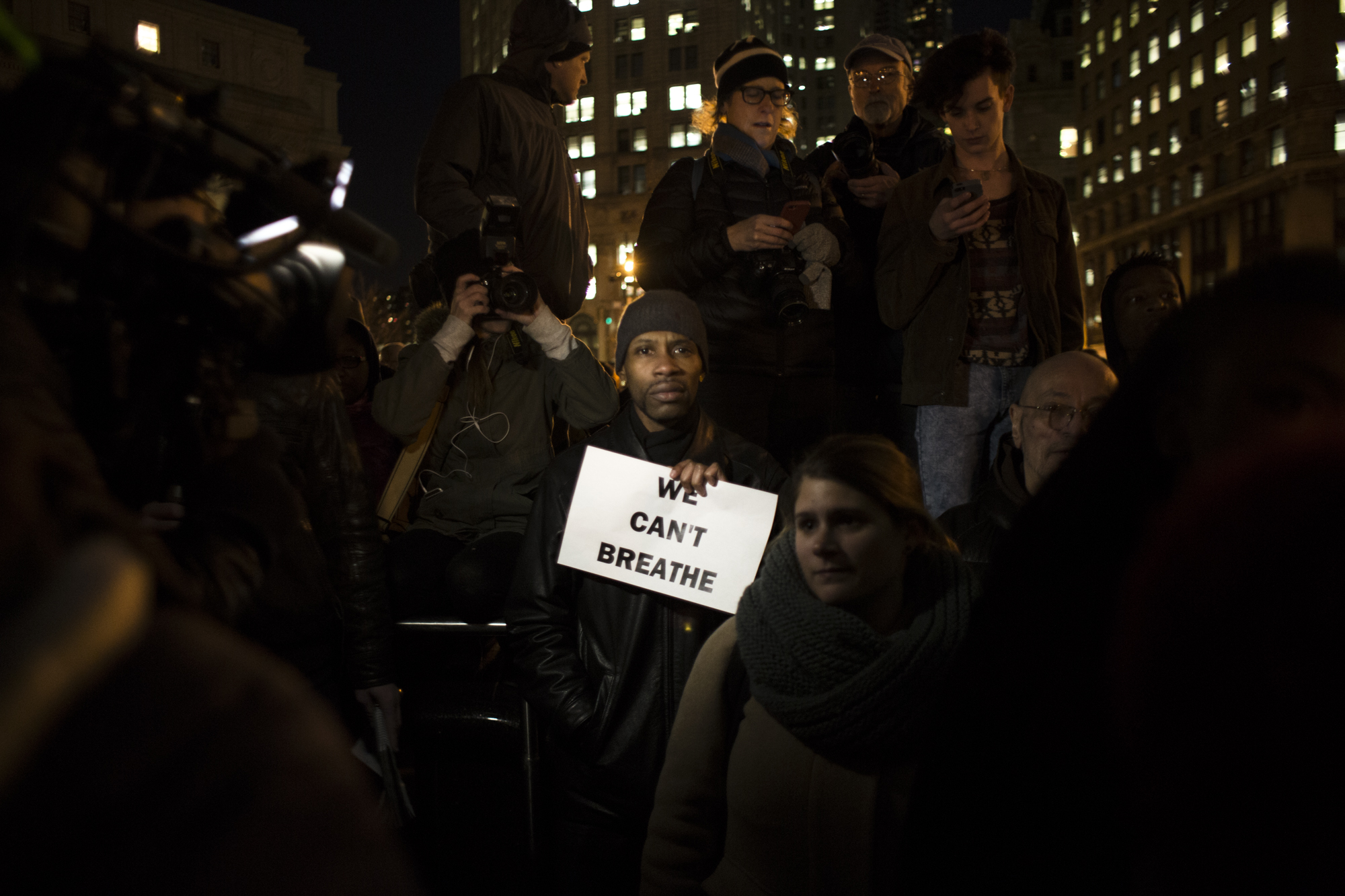 A man holds a sign with Eric Garner's last words at a protest last night. (Daniel Cole for New York Observer)