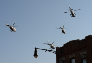 """Helicopters in the """"missing man"""" formation. (DON EMMERT/AFP/Getty Images)"""