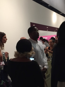 Sean Combs at Art Basel this morning. Funny, he doesn't look delighted....