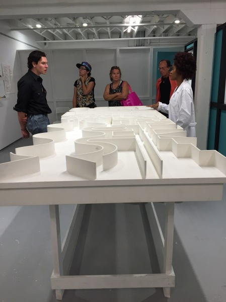 Volunteer therapists walk visitors through an interactive exhibit by Pedro Reyes titled Sanatorium at the new ICA Miami. (Photo by Alanna Martinez)