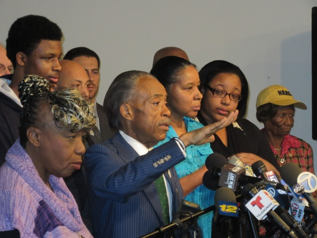 Rev. Al Sharpton, center, said a national march over police killings was necessary (Photo: Will Bredderman).