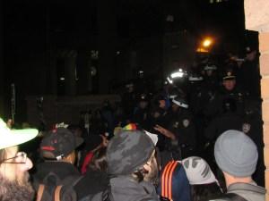 Demonstrators insult cops outside One Police Plaza (Photo: Will Bredderman).