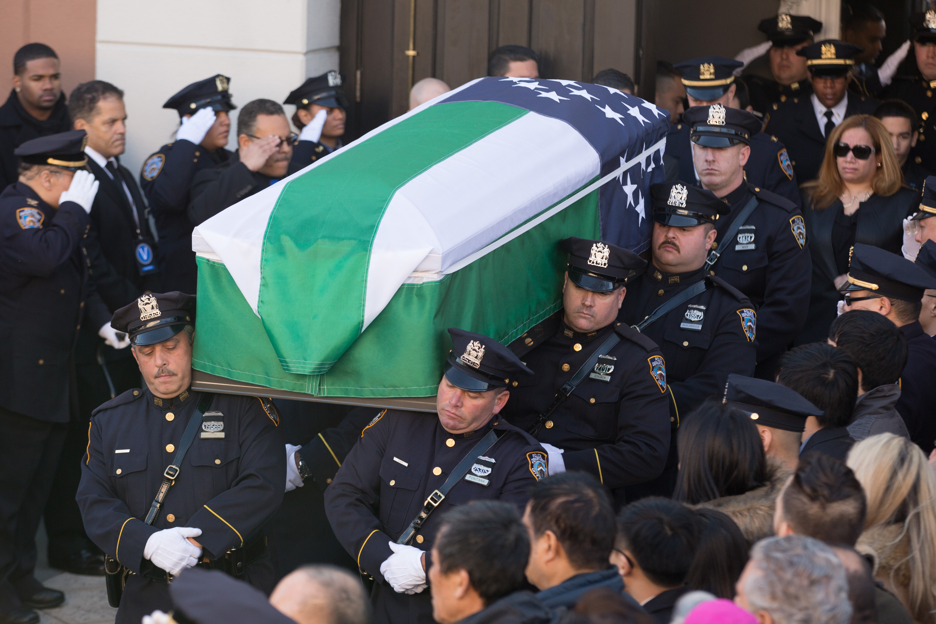 Pallbearers carry the casket for the funeral of slain New York Police Department officer Rafael Ramos at the Christ Tabernacle Church in Queens. (Photo by Kevin Hagen/Getty Images)