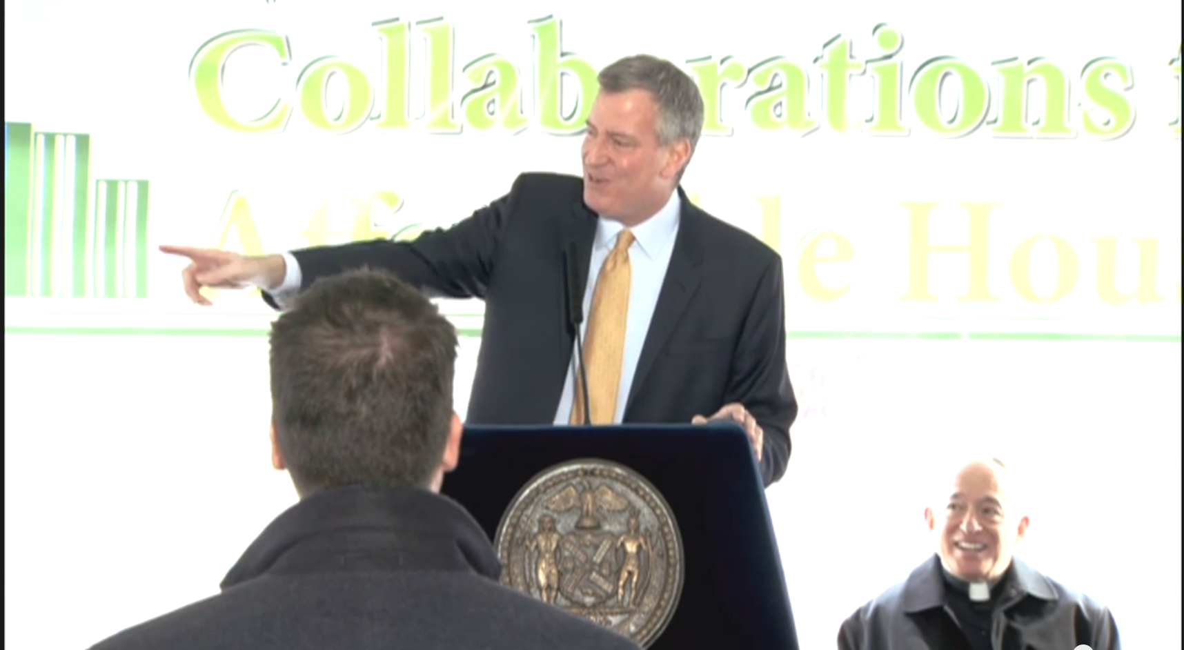 Mayor Bill de Blasio tries to move on to the next question while a Fox News producer persists. (Screenshot: Youtube)