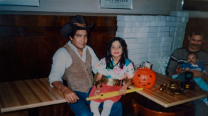 A childhood photo of Ms. Martinez and her father. (Change.org)