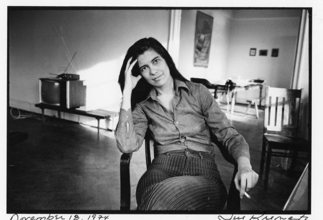 Sultry smoker Susan Sontag photographed in her home by Jill Krementz, November 18, 1974.