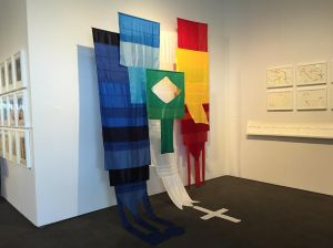 Andrea Canepa's hanging flags at Rosa Santos Gallery. (All photos by Alanna Martinez.)