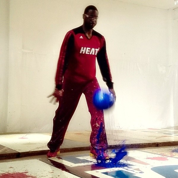 Dwayne Wade paints with basketballs. (Photo via Art of Miami, courtesy Dwayne Wade's Facebook)