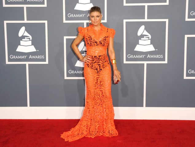 Fergie showing that it is possible for a dress to be both sheer and orange. (Photo via Getty)