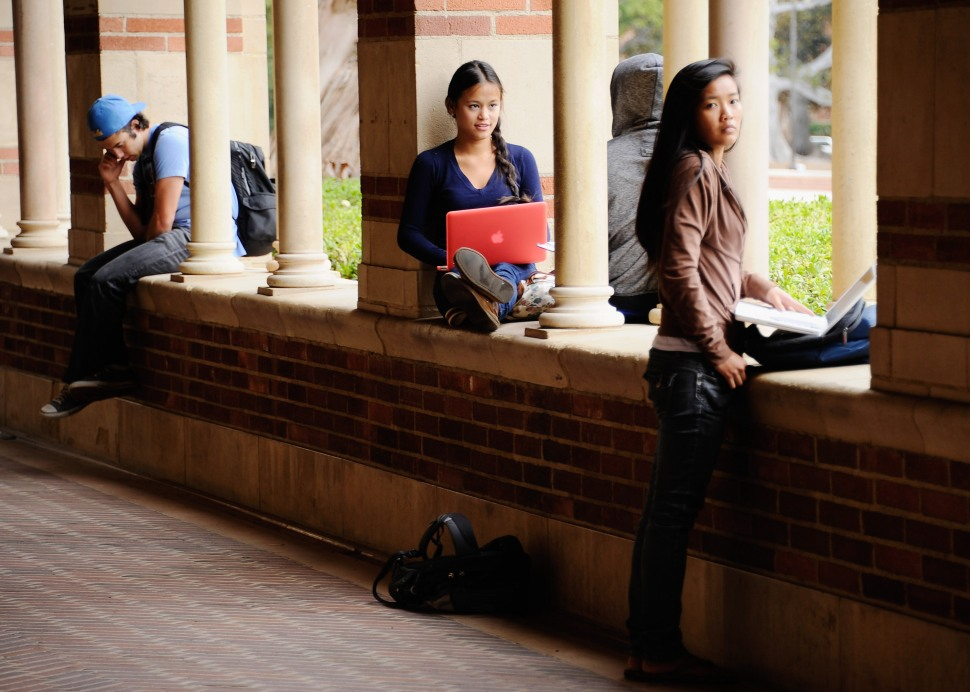 Students take a break at Royce Hall on the campus of UCLA on April 23, 2012 in Los Angeles, California.  They're probably aggrieved. And some of them are right to be aggrieved. (Photo by Kevork Djansezian/Getty Images)