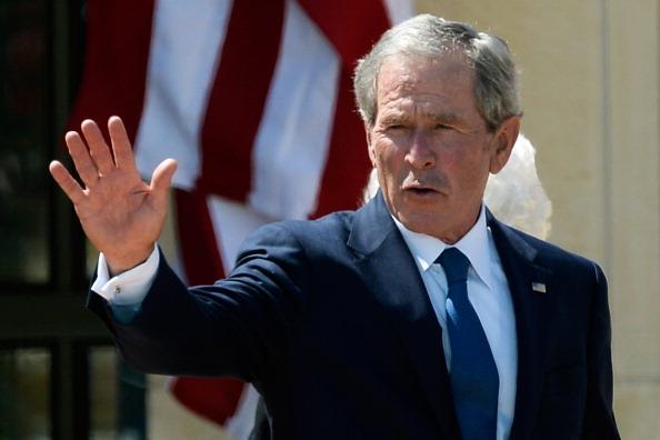 George W. Bush waves goodbye.