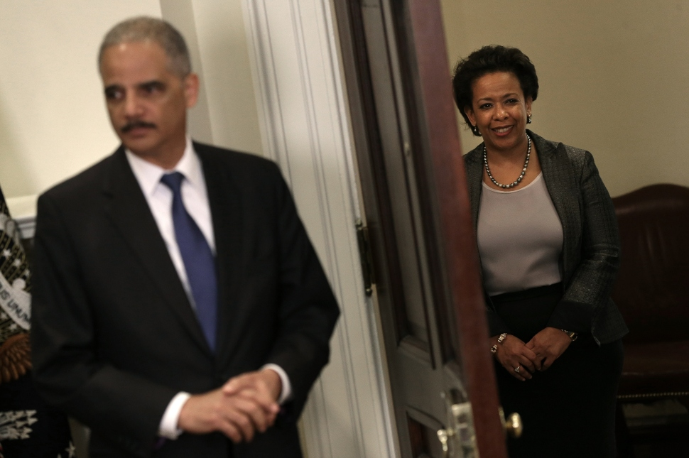 Attorney General nominee Loretta Lynch waits in the wings to replace Eric Holder following a ceremony in the Roosevelt Room of the White House, November 8, 2014. (Photo by Win McNamee/Getty Images)