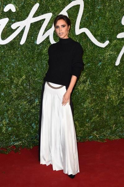 Victoria Beckham always looks a little mischievous. (Photo via Getty)