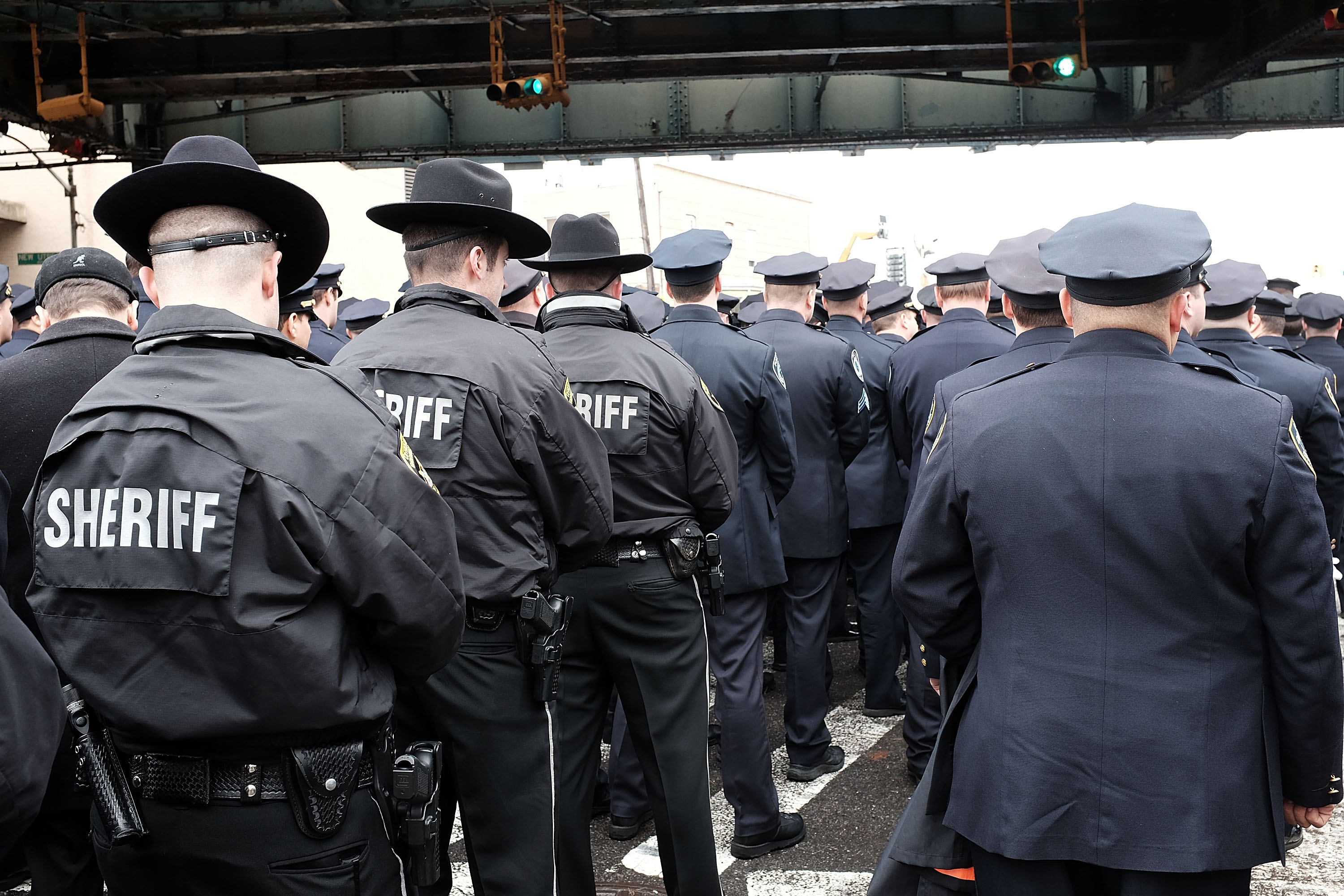 Hundreds of police officers from across the country turned their backs as New York Mayor Bill de Blasio speaks during the funeral for  Wenjian Liu January 4, 2015 in New York City (Photo: Spencer Platt/Getty Images).