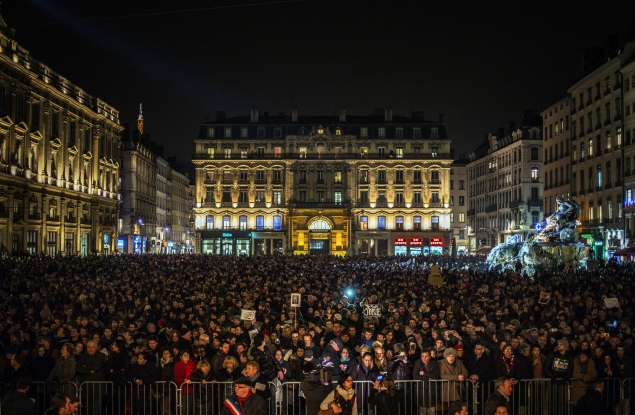 People gather during a Lyon vigil for Charlie Hebdo victims. How about Mecca next? (AFP/Getty Images)