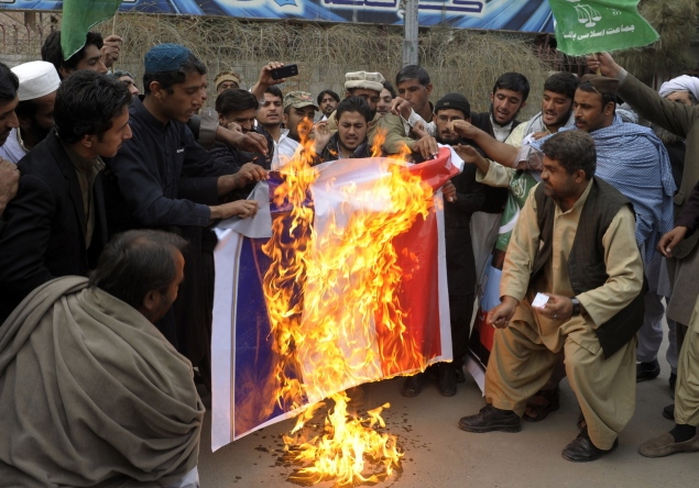 Pakistani demonstrators burn a French flag during a protest against the printing of sketches of the Prophet Muhammad by  Charlie Hebdo. (BANARAS KHAN/AFP/Getty Images)