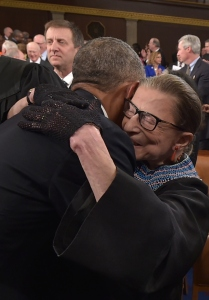 President Barack Obama hugs Supreme Court Justice Ruth Bader Ginsburg as he arrives to deliver the State of the Union address (Photo: Getty Images).