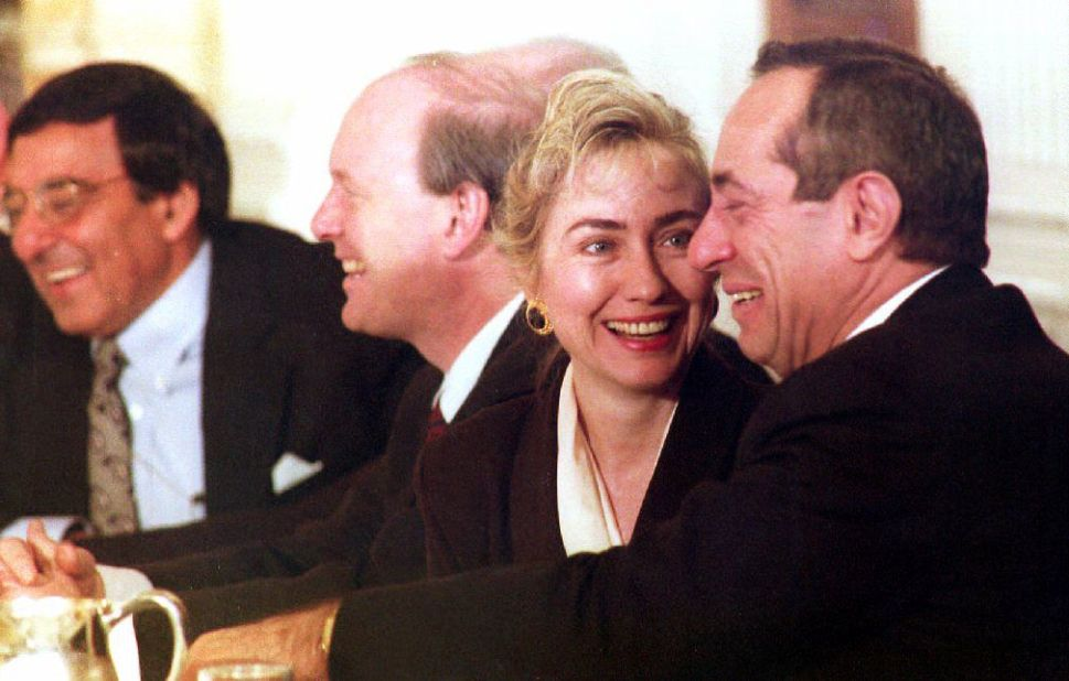 First Lady Hillary Clinton smiles at New York Gov. Mario Cuomo  in February 1993 during a meeting with U.S. governors to discuss health care initiatives; Director of the Office of Management and Budget Leon Panetta looks on. (JENNIFER LAW/AFP/Getty Images)