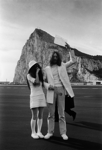 John Lennon and Yoko Ono wed in white, in Gibraltar, March 20, 1969. (Photo via Getty)
