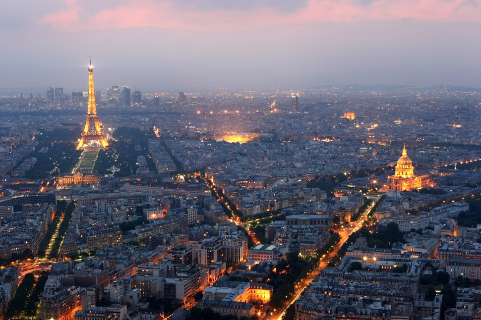 view of Paris at dusk with the Eiffel Tower and the Hotel des Invalides prominent on June 10, 2008 in Paris, France. (Photo by Mike Hewitt/Getty Images)