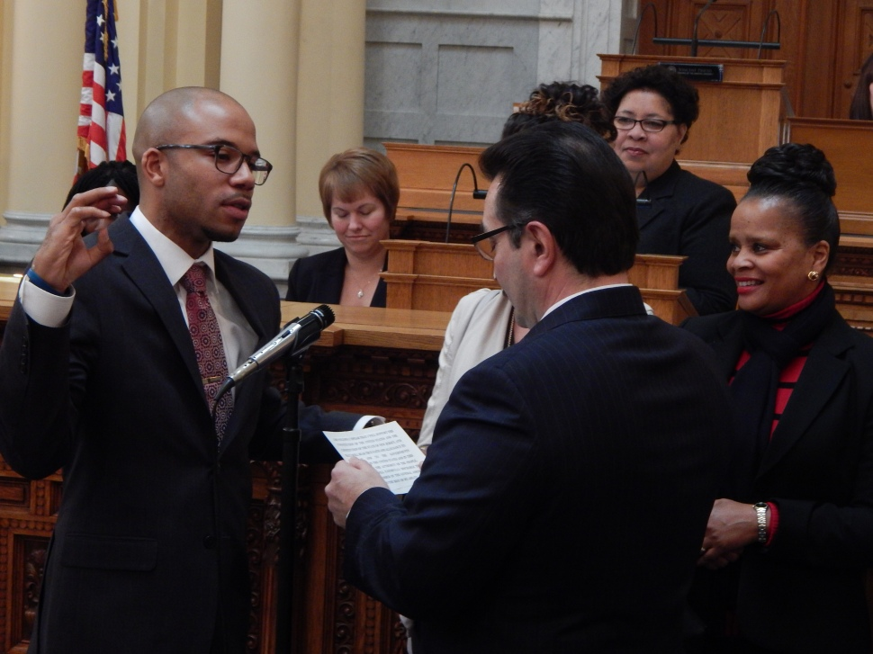 Assembly Speaker Vinnie Prieto administers the oath of office for Taliaferro.