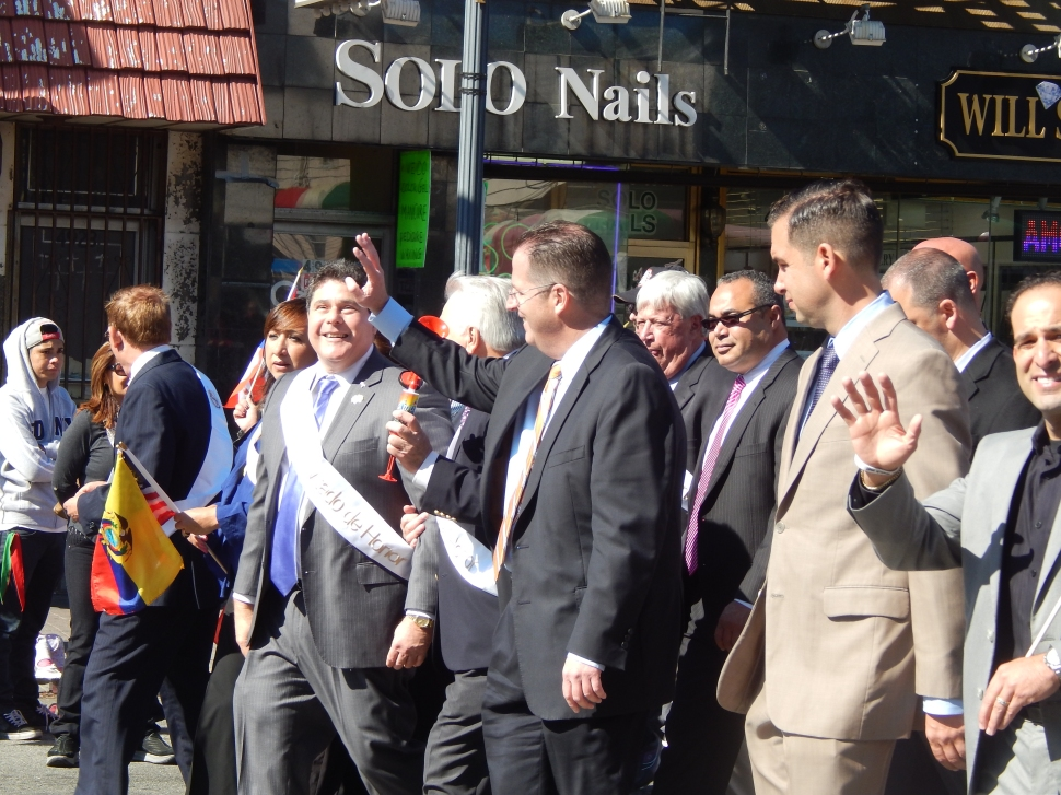 Mayor Roque, at left, marches in Hudson.