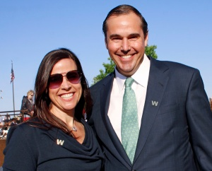 Ray and Heather Washburne wear their support for another Texas GOPer on their lapels.