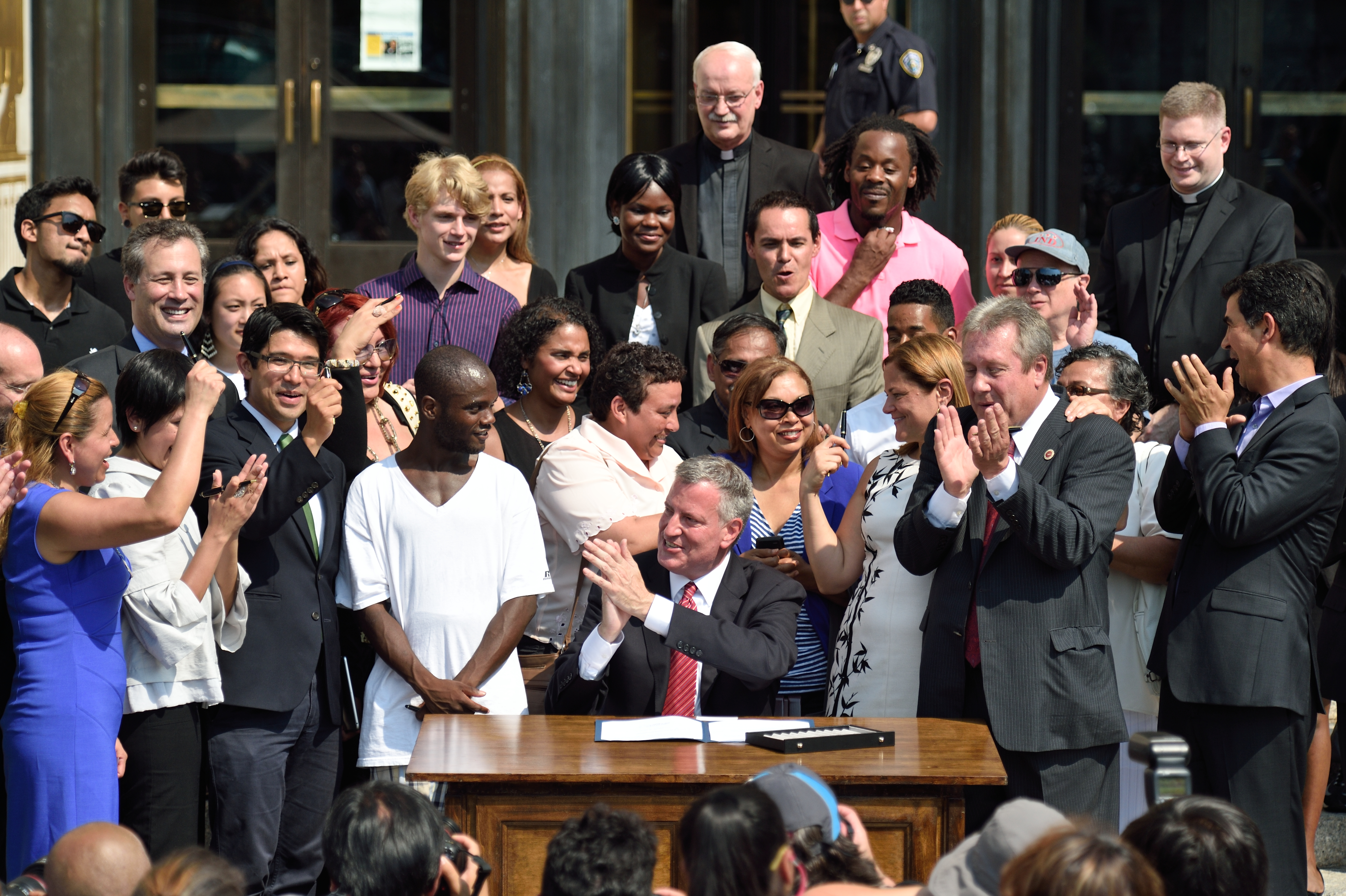 Mayor Bill de Blasio signs the municipal I.D. law. (Photo: Rob Bennett/Mayoral Photography Office)