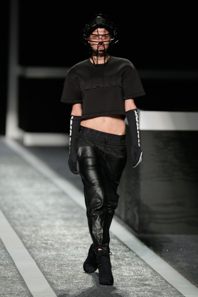 A model walks the runway at the Alexander Wang X HM, donning sports inspired headgear (Photo by Randy Brooke/Getty Images Entertainment)