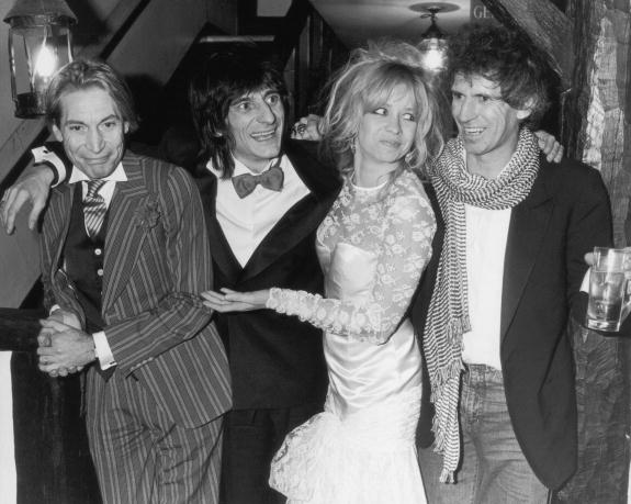 Charlie Watts (left) and Keith Richard (right) were the best men at Ronnie Wood's marriage to Jo Wood on Jan. 2, 1985. (Photo via Getty)