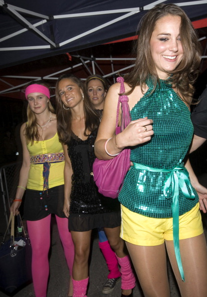 Kate  pulling off nude tights and looking ecstatic with her girlfriends in 2008. (Photo via Getty)