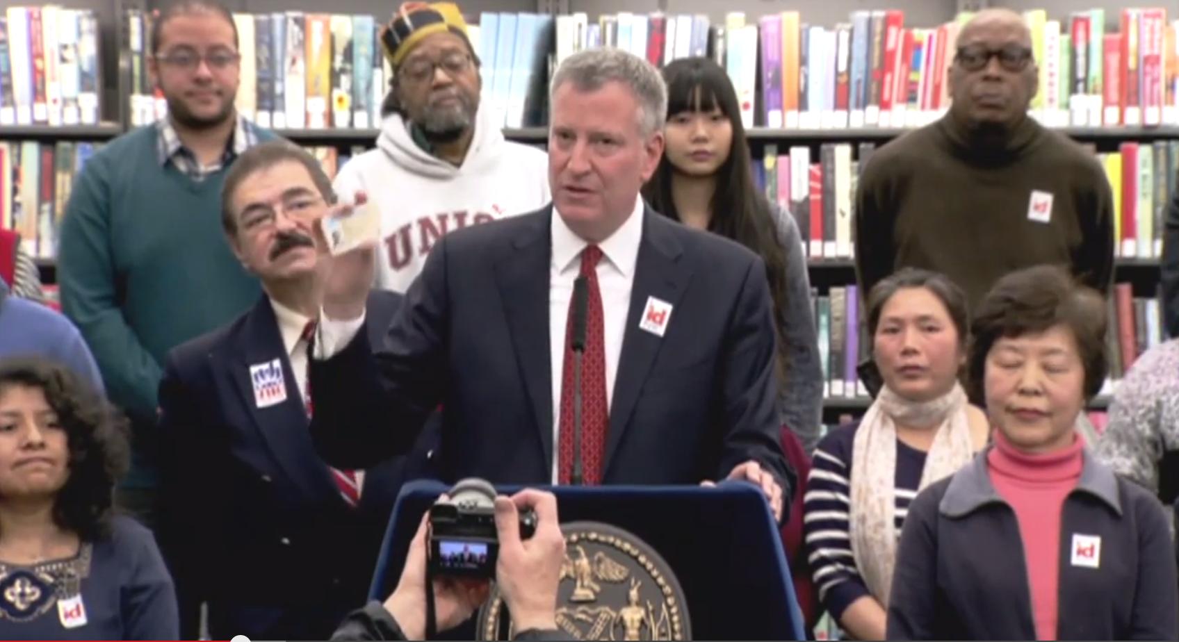 Mayor Bill de Blasio shows off his new municipal I.D. card. (Screengrab: Youtube)