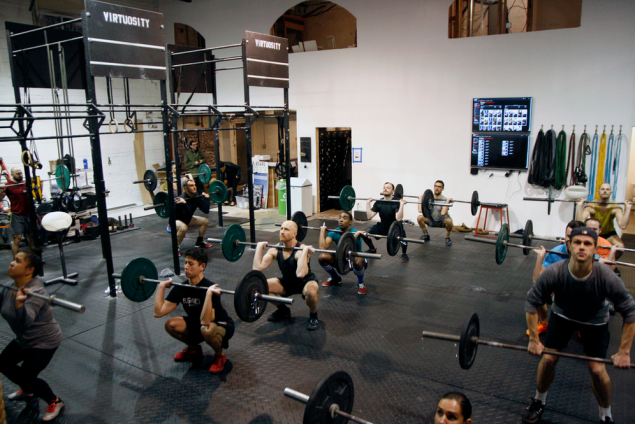 A group work-out at CrossFit Virtuosity's new location. (Flickr)
