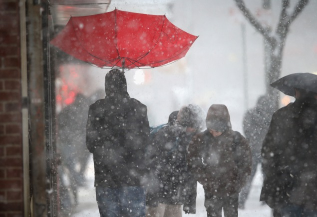 A person with an umbrella in the snow. (Photo: Getty Images)