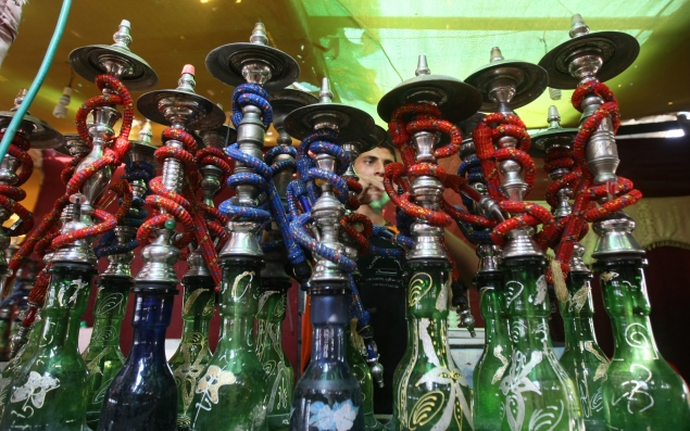 A Palestinian worker makes ready flavoured tobacco water pipes or 'shisha' prior to the evening influx of customers in Gaza City on July 17, 2010, as the ruling Islamic Hamas party tries to impose a ban on smoking water pipes in public. MAHMUD HAMS/AFP/Getty Images