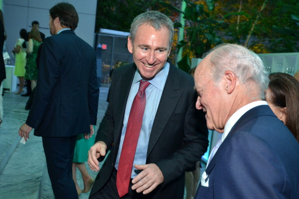 Ken Griffin, chief executive officer and founder of Citadel LLC, (left) and Henry Kravis, co-chairman of KKR & Co., at the Museum of Modern Art's 'Party in the Garden' in 2013. (Photo: Amanda Gordon/Bloomberg via Getty Images)