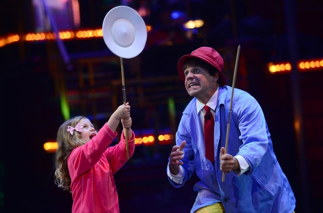 """Clown Rob Torres plays his act with a young audience member during """"Luminocity"""" by the Big Apple Circus in New York. EMMANUEL DUNAND/AFP/Getty Images"""