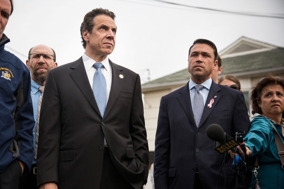New York Governor Andrew Cuomo (L) and New York Rep. Michael Grimm (R) NEW YORK, NY - OCTOBER 29. (Photo by Andrew Burton/Getty Images)