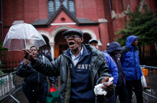 An angry man at the funeral of Akai Gurley last year. (Photo: Kena Betancur/Getty Images)