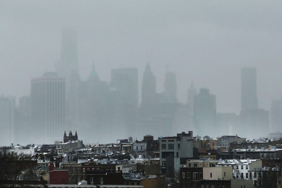 The New York City skyline is shrouded in snow on January 26, 2015 (Photo by Spencer Platt/Getty Images)