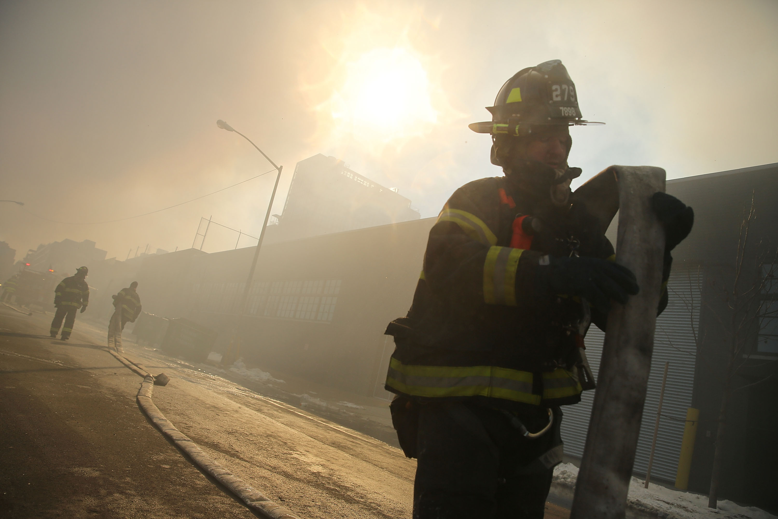 A firefighter at work in Williamsburg last week. The 911 system overhaul integrated the fire, police and EMS departments' call-taking and dispatch.   (Photo by Spencer Platt/Getty Images)