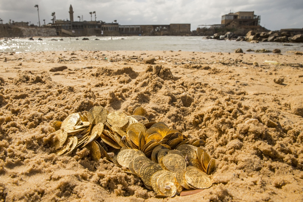 Gold coins recently found off Israel's Mediterranean coast displayed in the sand in the Israeli town of Caesarea (Photo: Jack Guez/AFP/Getty Images).