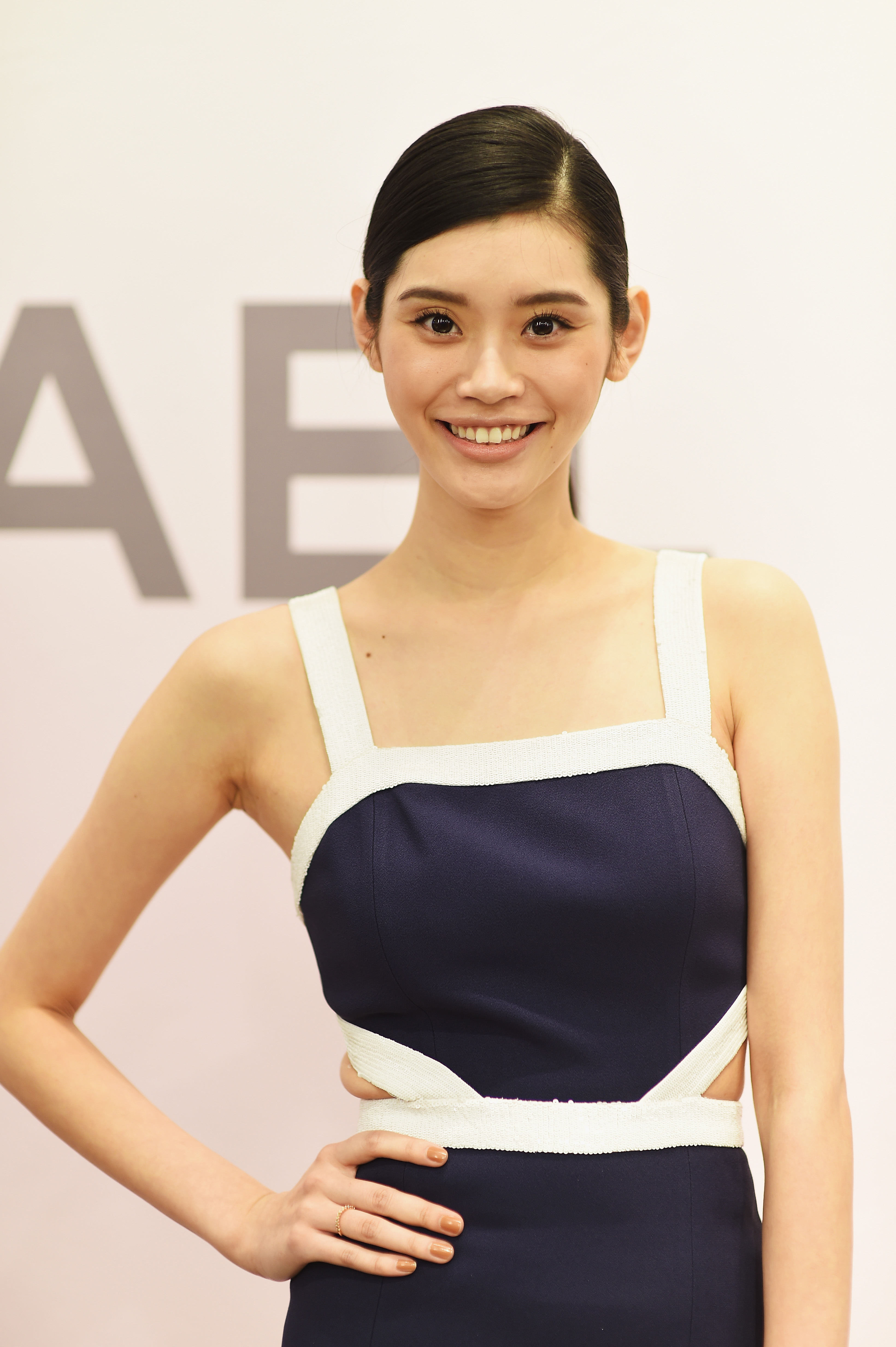 Ming Xi in a sunny frock (Photo: Getty).