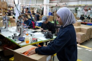 A Palestinian woman works at the Israeli  SodaStream factory in the Mishor Adumim industrial park, next to the West Bank settlement of Maale Adumim. The company employs 800 Palestinians and 500 Israelis at the plant. (MENAHEM KAHANA/AFP/Getty Images)
