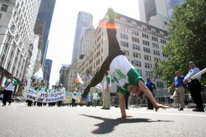 Yitzie Nissel, 9, of Passaic, NJ, demonstrates his pride for Israel on 5th Avenue. (Hiroko Masuike/Getty Images)