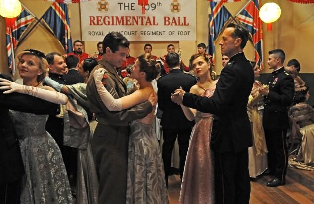 (L-R) Callum Turner (Bill Rohan) dancing with Aimee-Ffion Edward