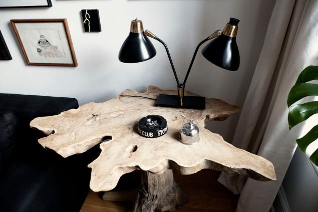 A teak root table with an antique lamp. Photo: Celeste Sloman/New York Observer